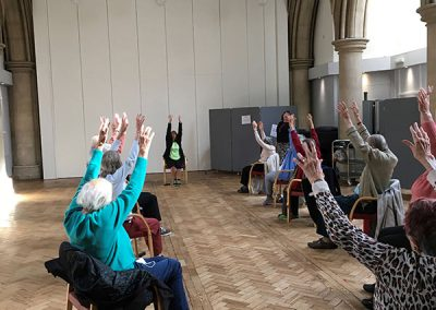 Seated exercises at The Avenue Club, Kew